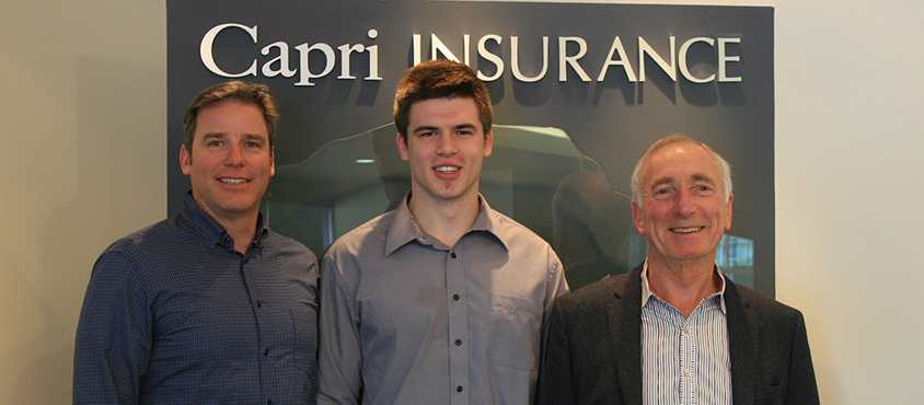 Photo: Capri Insurance's Tim Miller(L) and Robin Durrant (R) congratulate student athlete Buster Truss (centre) on being the sixth recipient of the annual Capri Insurance Athletics Entrance Scholarship