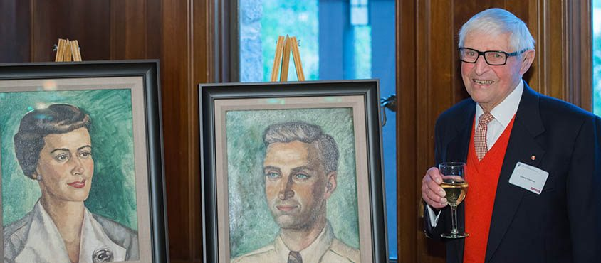 Sydney Friedman stands with portraits of himself and his wife Constance. Photo: Don Erhardt/UBC